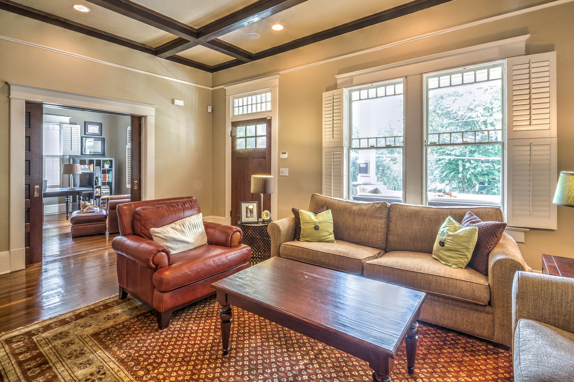 Craftsman living room with beamed ceilings