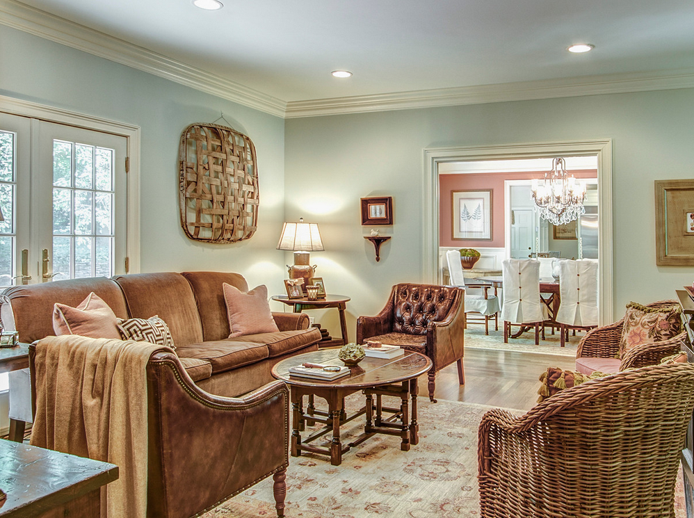 family room with wood chairs and a basket on the wall