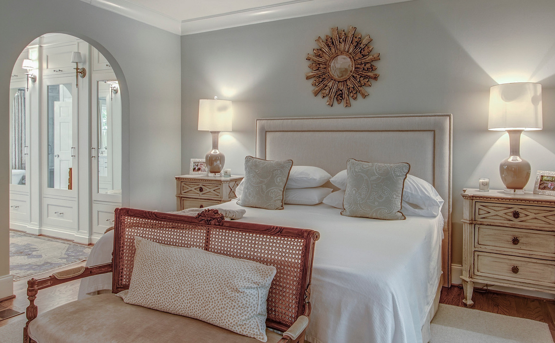 Master Bedroom with fabric headboard and arch to master bath