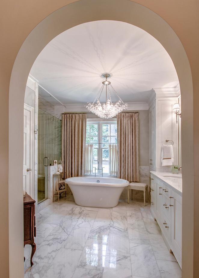 Arch leading to master bath