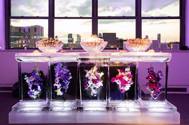 Serving up seafood goodies on top of nature's beauties❄️ #IceBar #Flowers #FrozenInside #rawbar #seafoodrawbar #OkamotoStudio