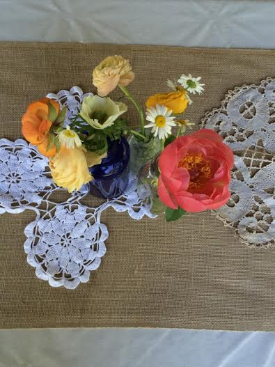 The bride and family stitched together all of these beautiful family doilies.
