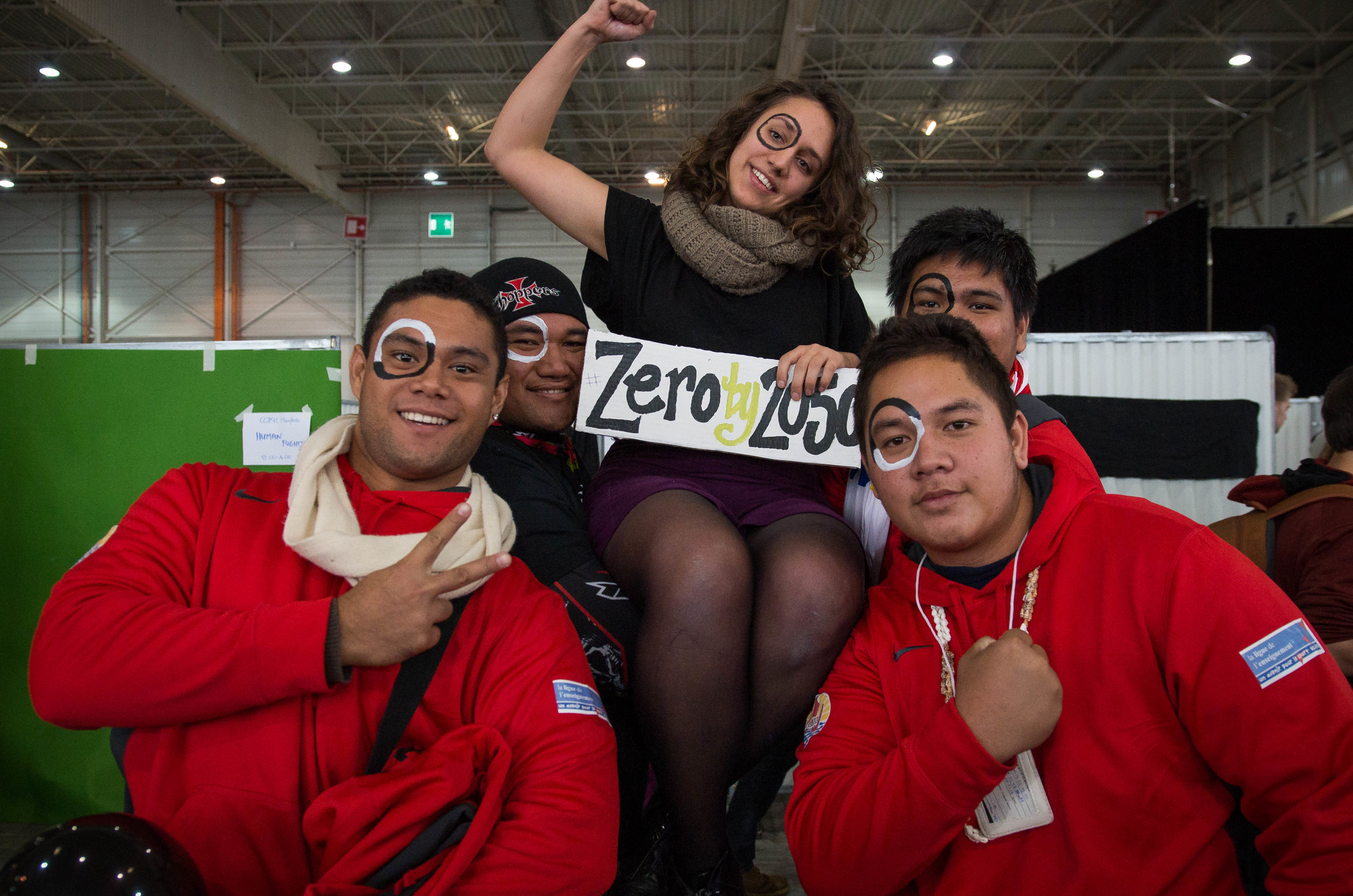 US organizer and SustainUS Delegation leader Dyanna Jaye championing Zero by 2050, being supported by delegates from French Polynesia