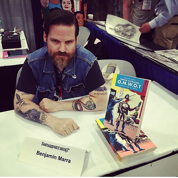 We got to hang out with this monkey-fucker all weekend. This is artist, writer, poet barbarian and HUMANS pin-up artist, Benjamin Marra. He was at SDCC signing his killer new book, OMWOT (One Man War On Terror) out soon from Fantagraphics! If you haven't looked into his work, stop fuckin' around and get to it!