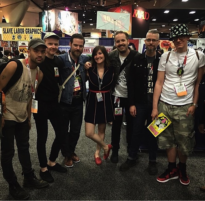 Always at the center of the party Jach Cohen made us pose at the Fantagraphics table. Left to Right: Michael DeForge, Patrick Kyle, Benjamin Marra, Jacq Cohen, KMK, Tom Neely, and Ed Piskor.