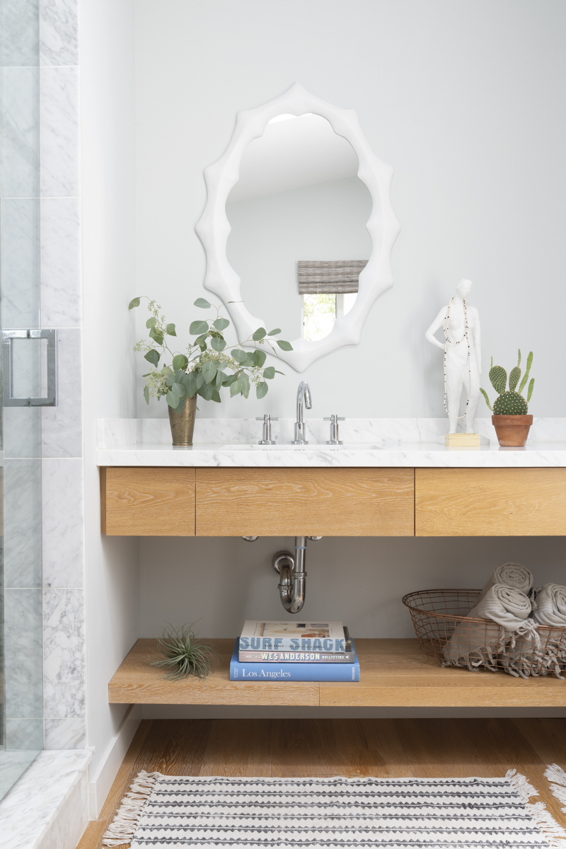 This master bath was so much fun to design. I usually switch up the decor each season with new books, towels, and accessories.  Photo by Annie Meisel.