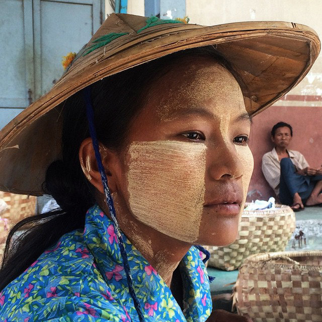 Working in the scorching Mandalay market, Khin Mar  Win  wears thick Thanaka stripes along with a bamboo hat to protect her from temperatures that regularly soar above 40ºC (104ºF).