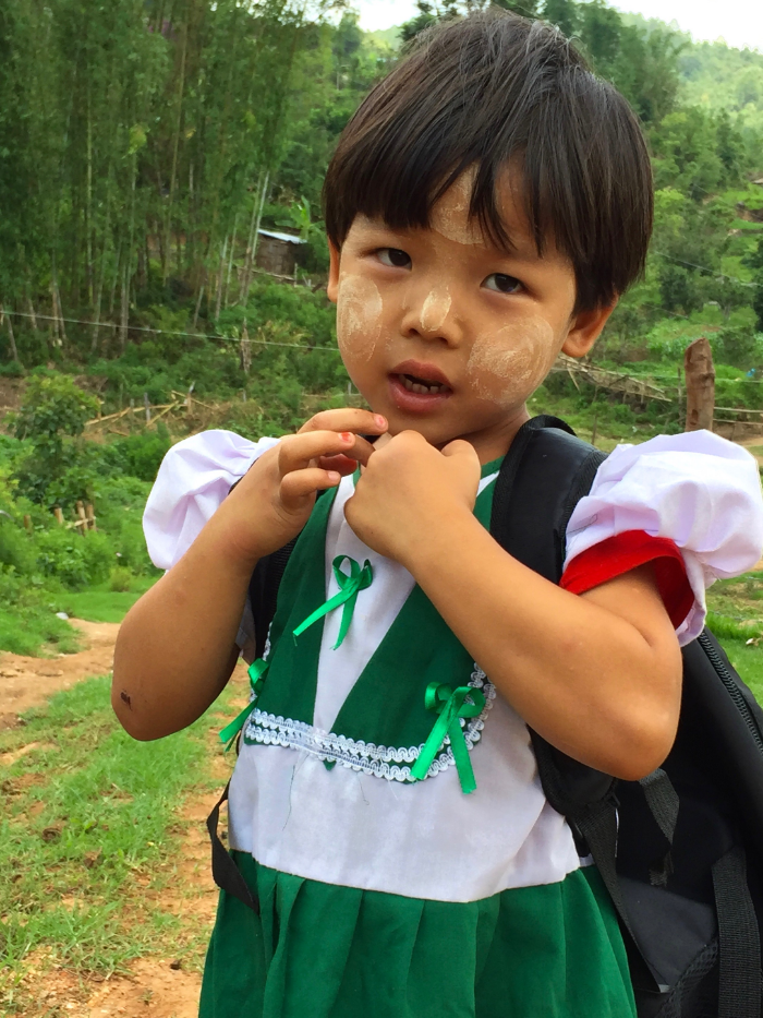 A Lahu girl walking home from school in eastern Shan State. The Lahu, like the Pa-O, have also begun to integrate Thanaka into their lives as a result of federal schooling.