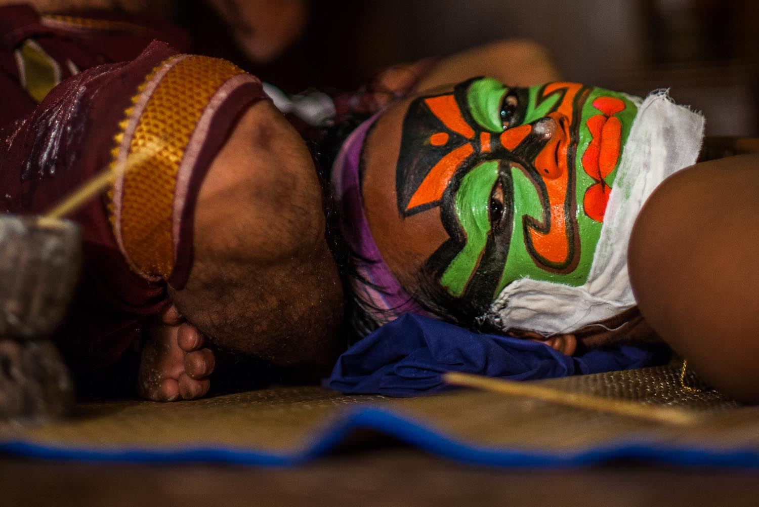 Kathakali performer getting his make up done. Kathakali is a Classical South Indian dance: Kochi, Kerala