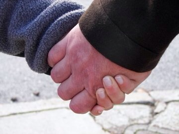 Holding Jeff's hand...
