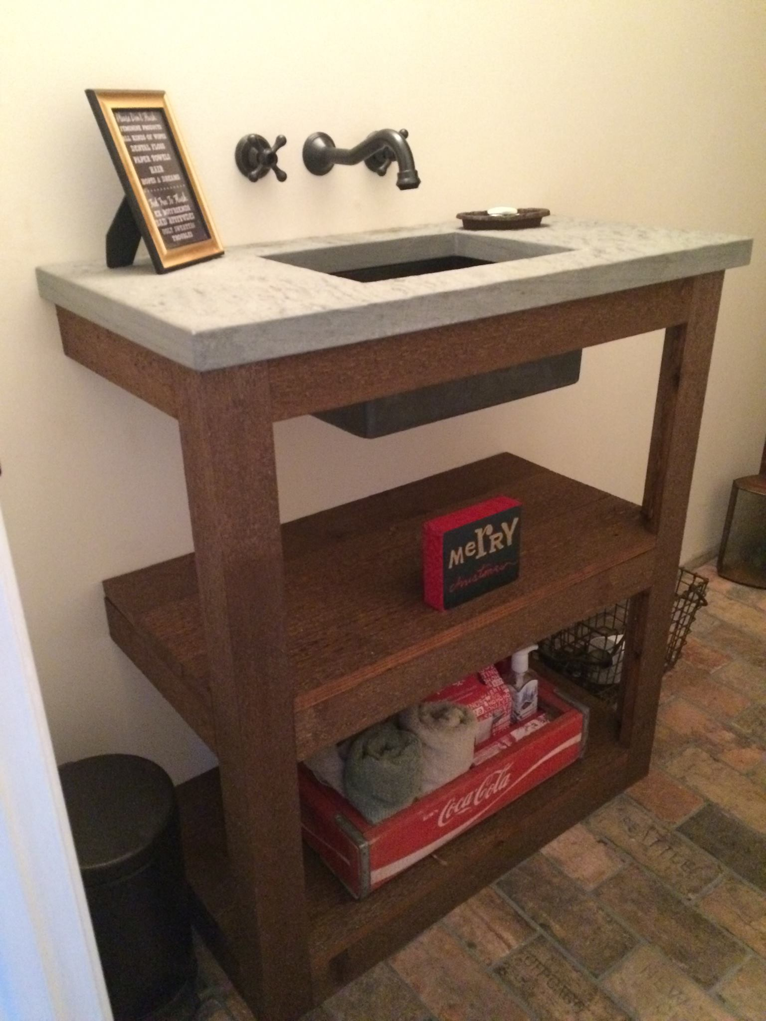 SHOUT OUT TO DREW for this beautiful custom built vanity to hold up the step countertop!!!!