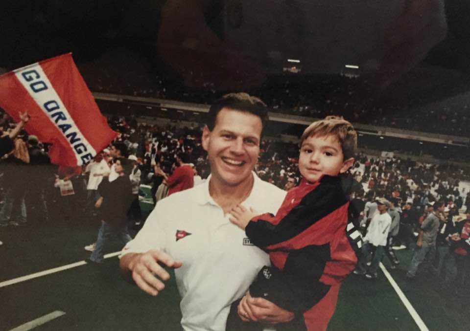 Father and son celebrating after a big football win!