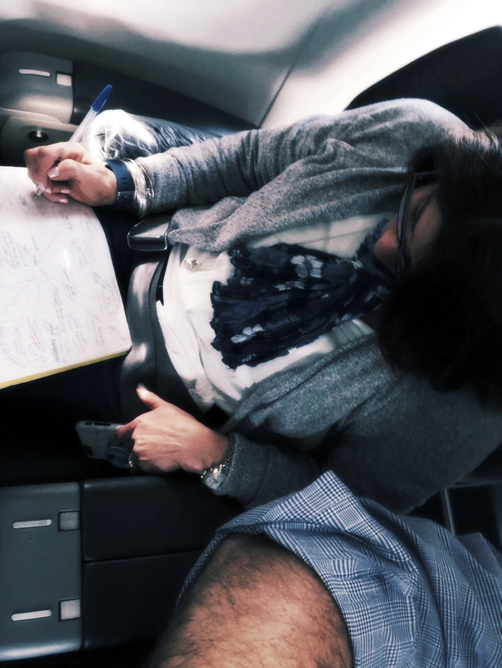 allison writing on a plane.jpg