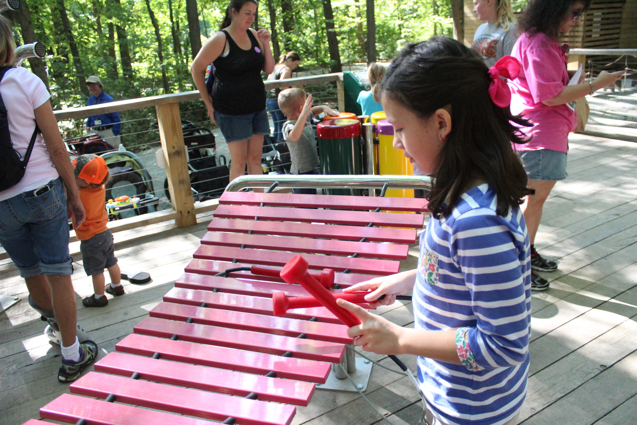 That's one cool big xylophone.  Playing music at the Treetop Outpost at Conner Prairie, Fishers Indiana