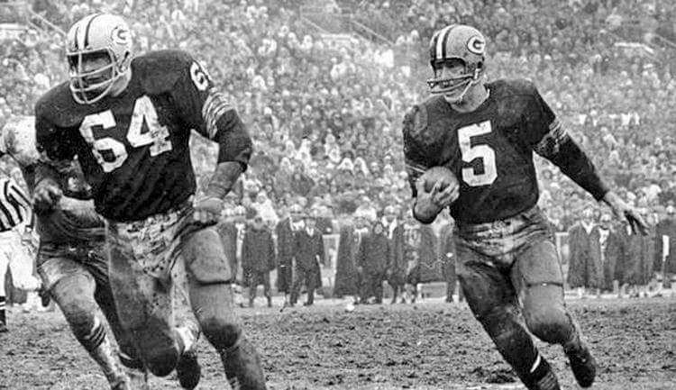Green Bay Packers halfback Paul Hornung (5) heads up field behind guard, Jerry Kramer (64) during the NFL championship against the Cleveland Browns at Lambeau field on January 2, 1966.