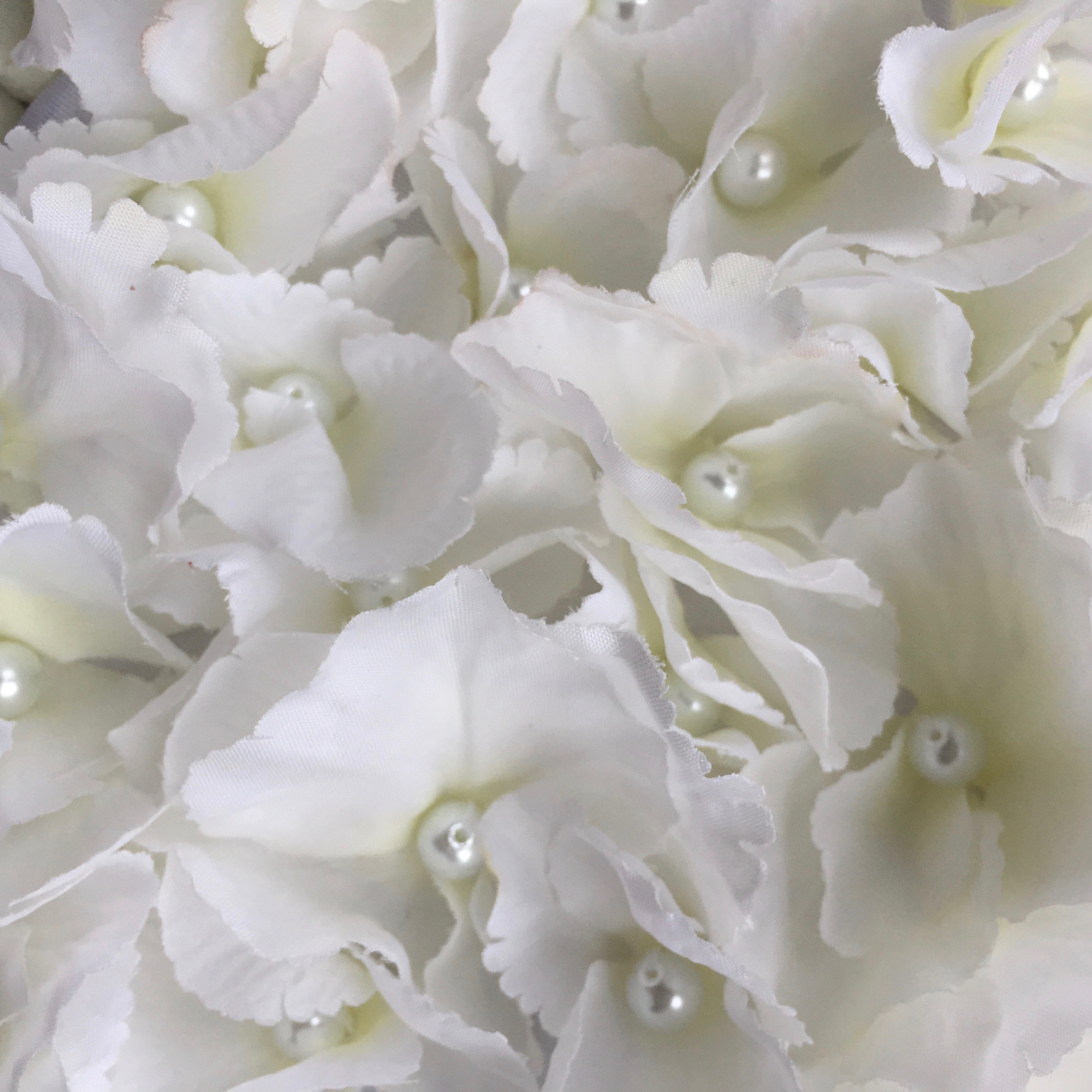 Close up of the hand stitched pearl centred hydrangeas.