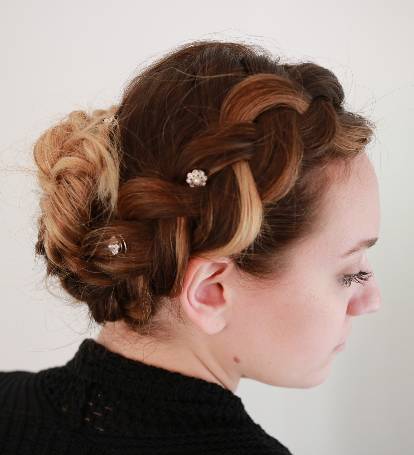 Dress this dutch braid up or down for a company holiday party or hanging at home decorating the Christmas tree | Styled by Emily