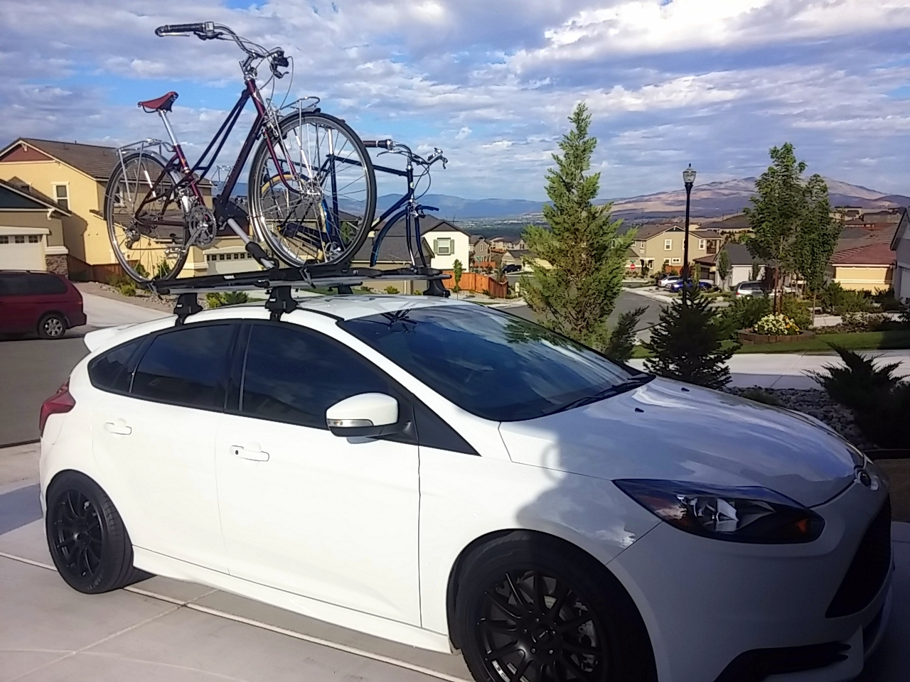 Ready for a bicycle adventure trip with our commuter bikes loaded on the roof of our car.