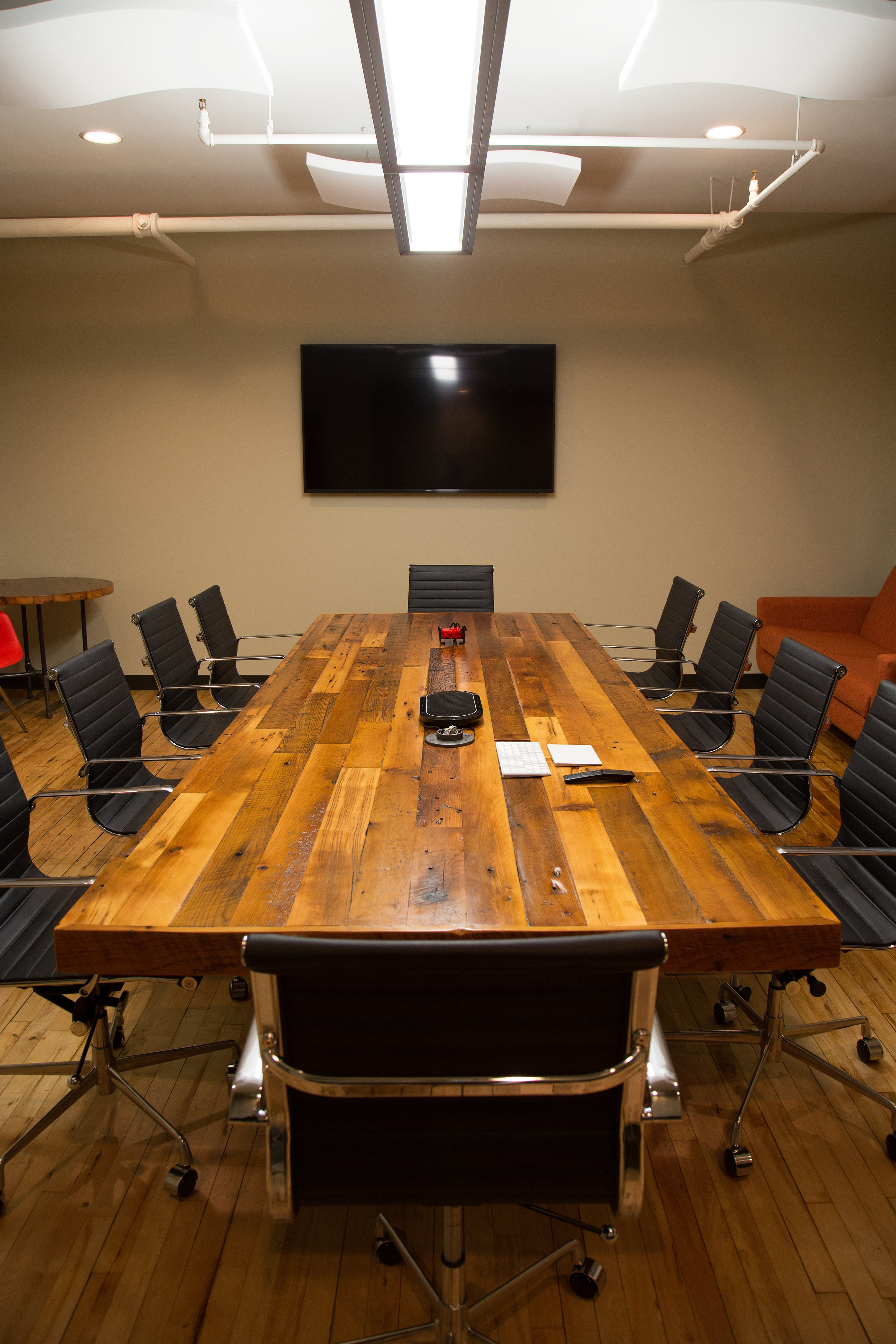 12' long conference table made out of reclaimed wood