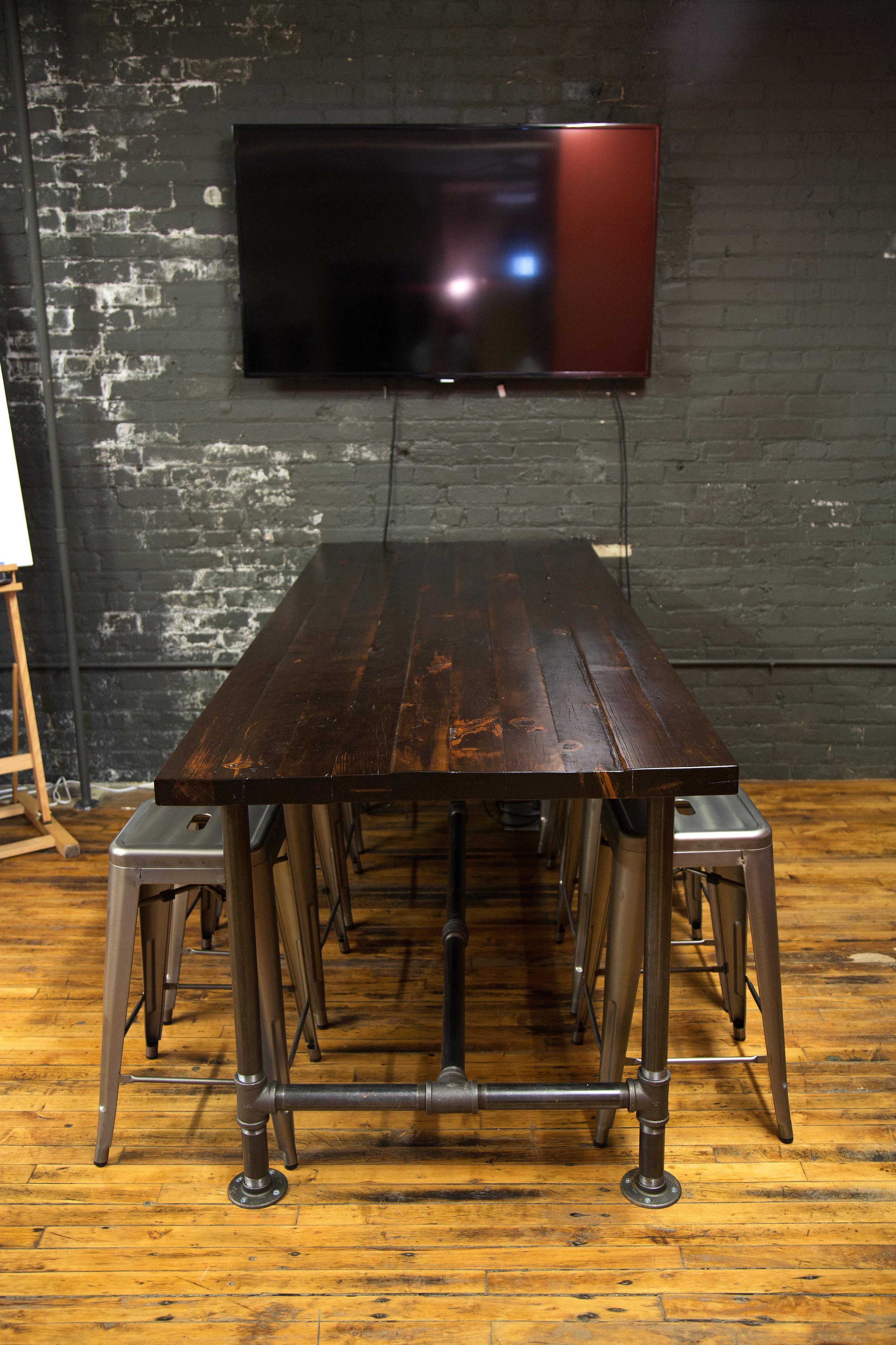 Reclaimed wood + black pipe break room table