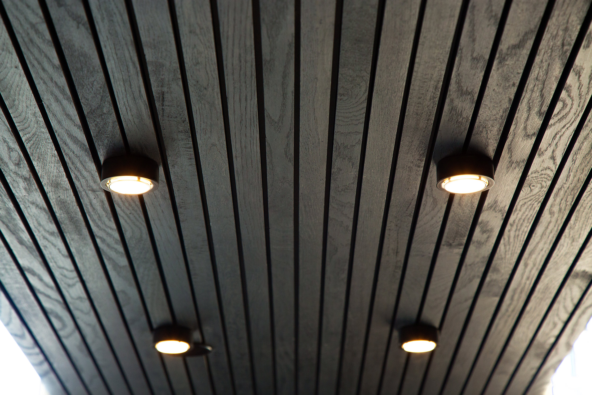 Lighting installed into the slatted soffit