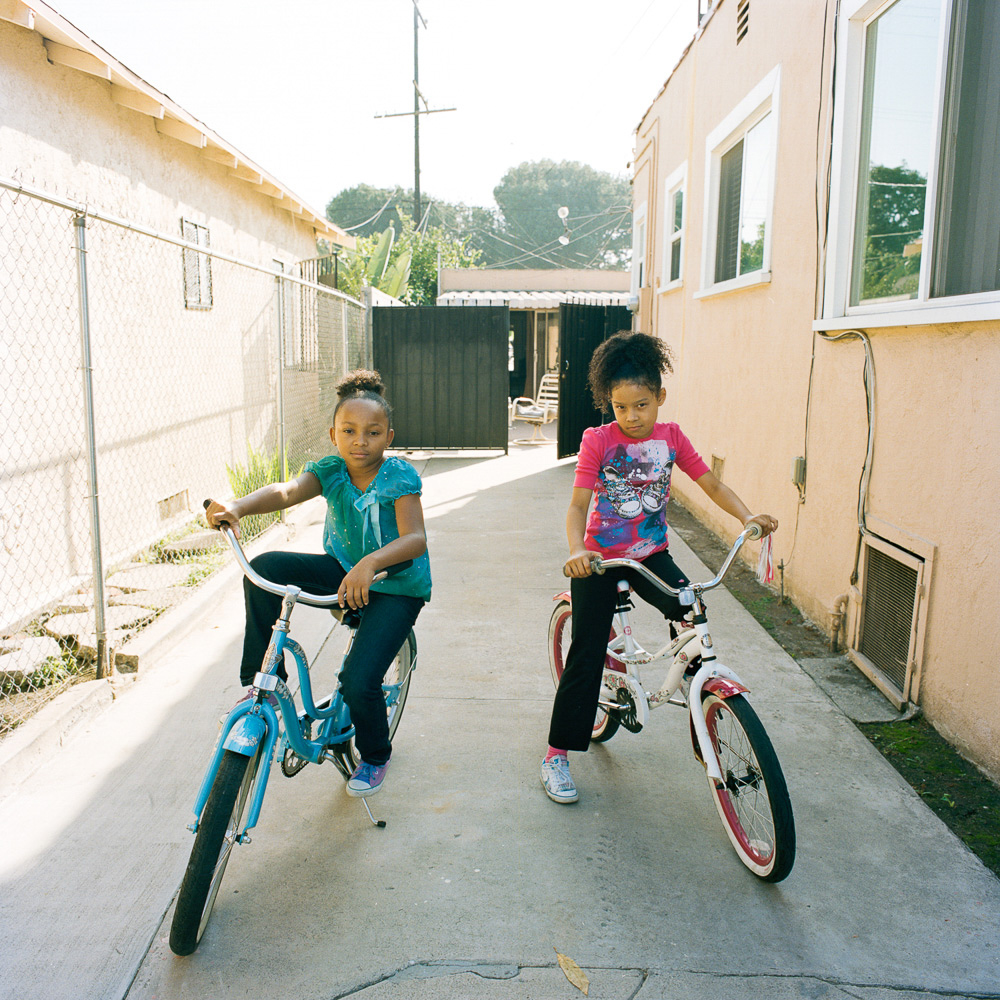 The girls could ride bikes from their house the neighbor's and back, Los Angeles  2013