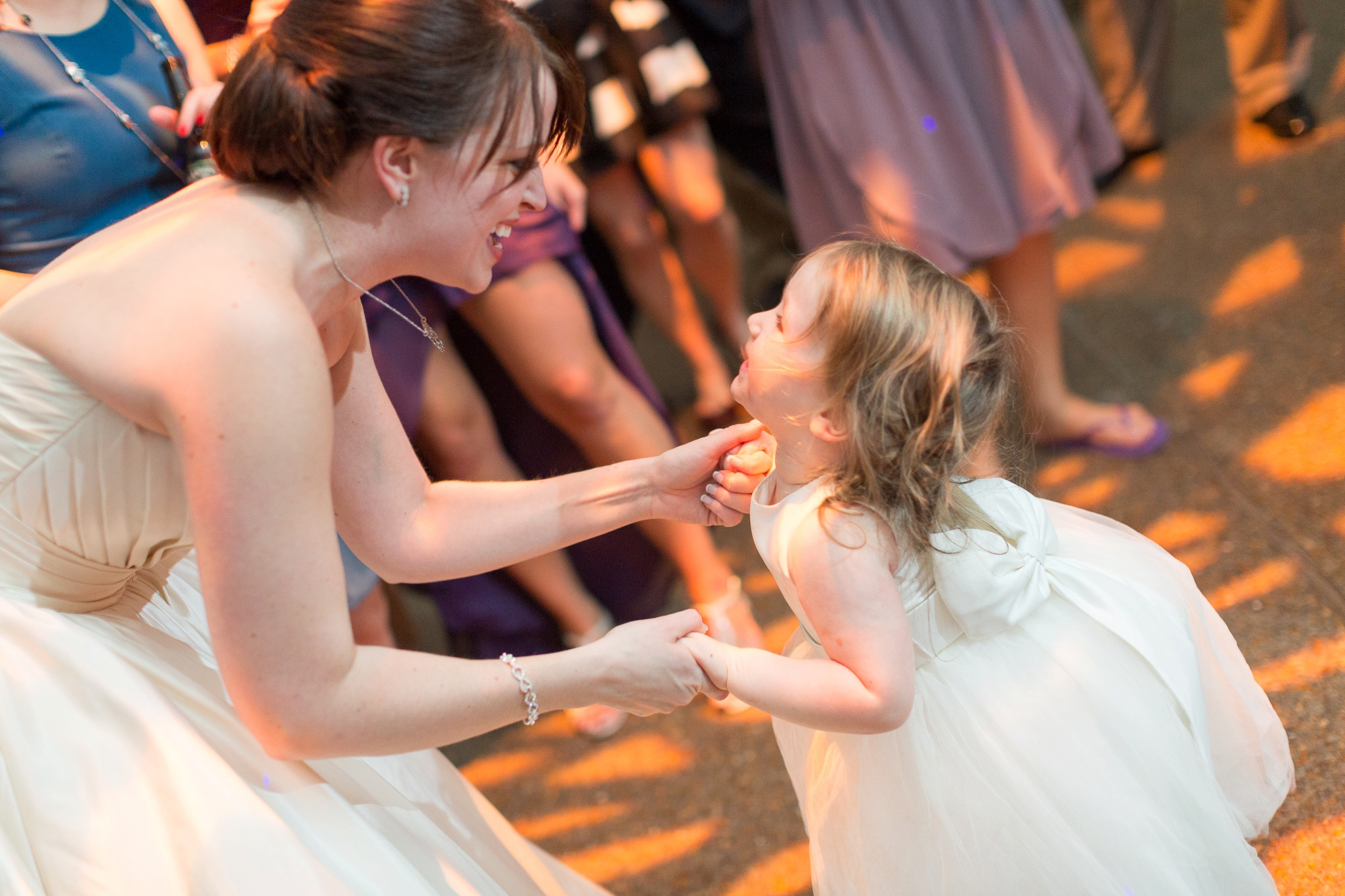 bride-and-flower-girl-dancing