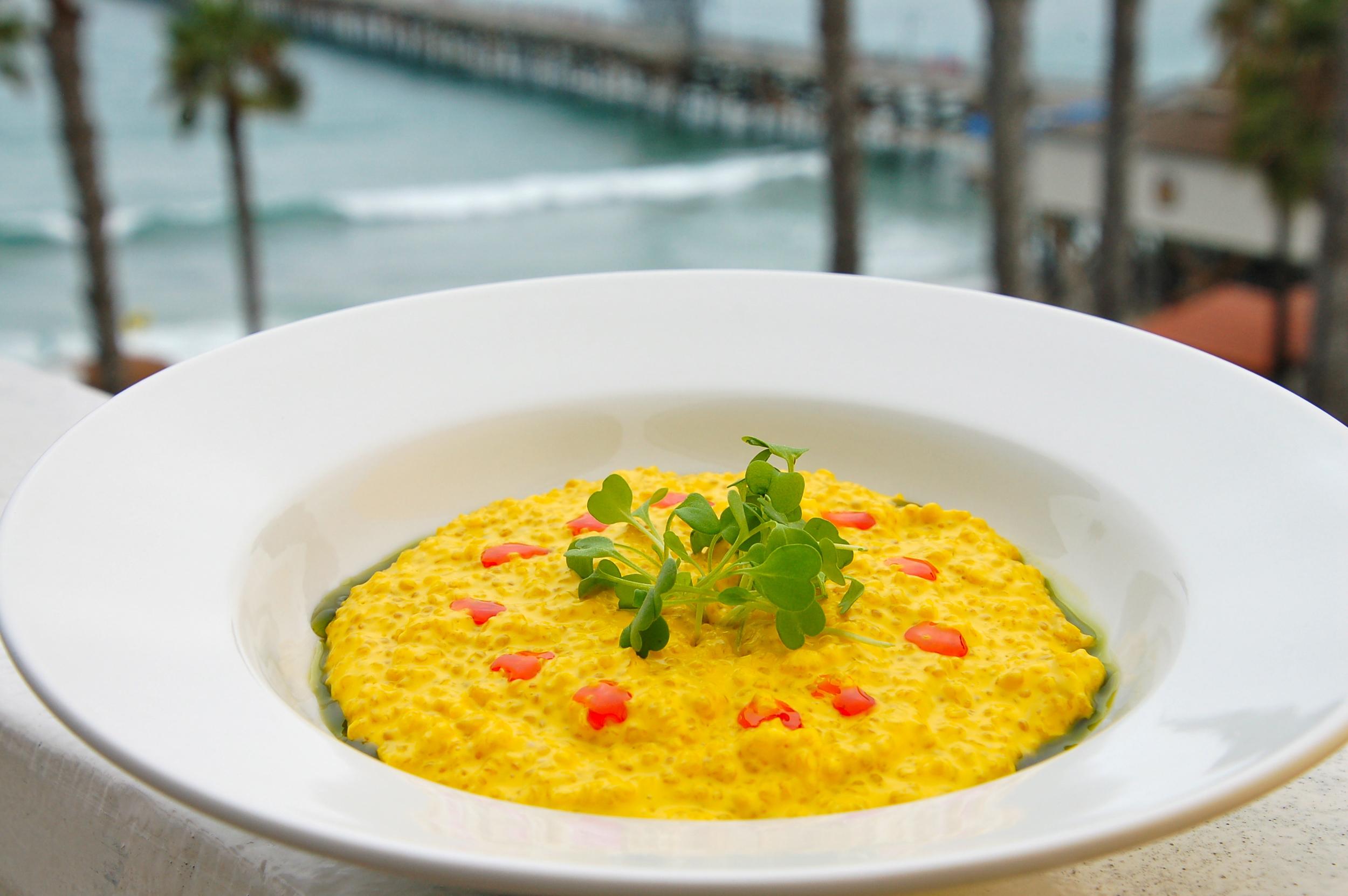 Quinotto Alla Millanese, quinoa saffron risotto, huacatay oil, micro arugula