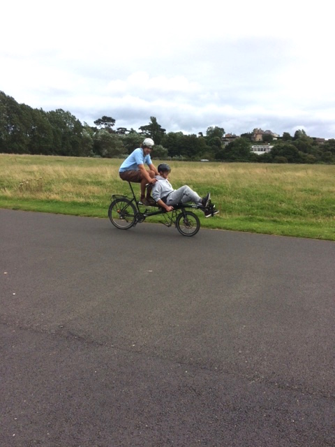 Chris test-riding a recumbent tandem. He loved the feeling of speed and was surprised just how fast it felt.