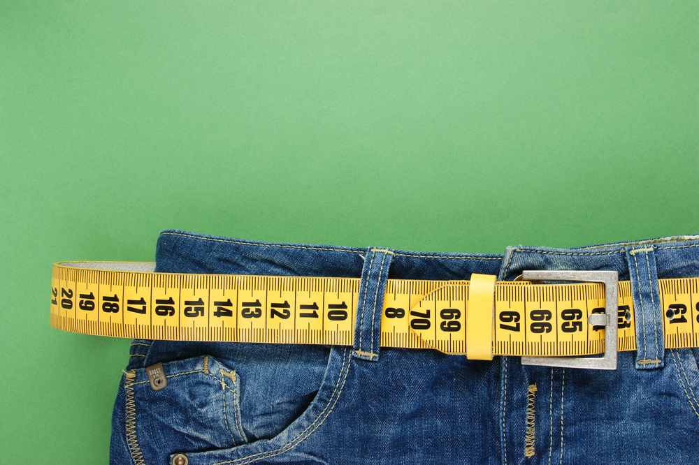 Weight loss tape measure jeans shutterstock_164062430.jpg