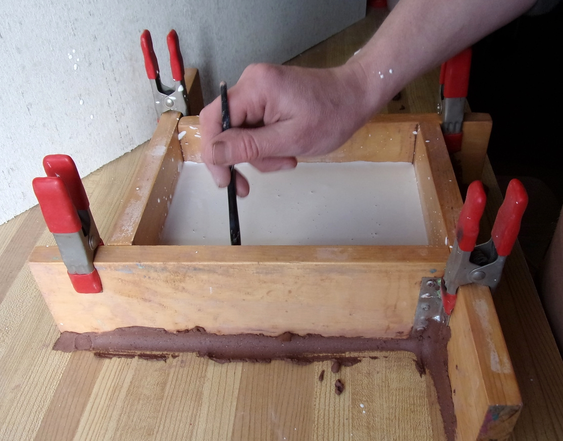 lifting air bubbles with paint brush