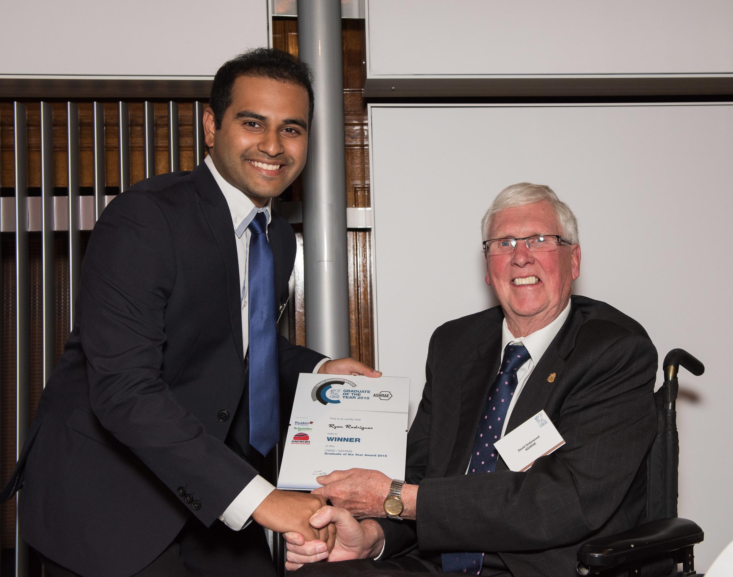 Ryan Rodrigues receives award from ASHRAE president.