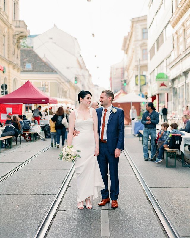Street festivals + one bride + one groom = one colorful moment. 💕 Taken on a #contax645 on #fuji400h, developed and scanned by @carmencitalab.