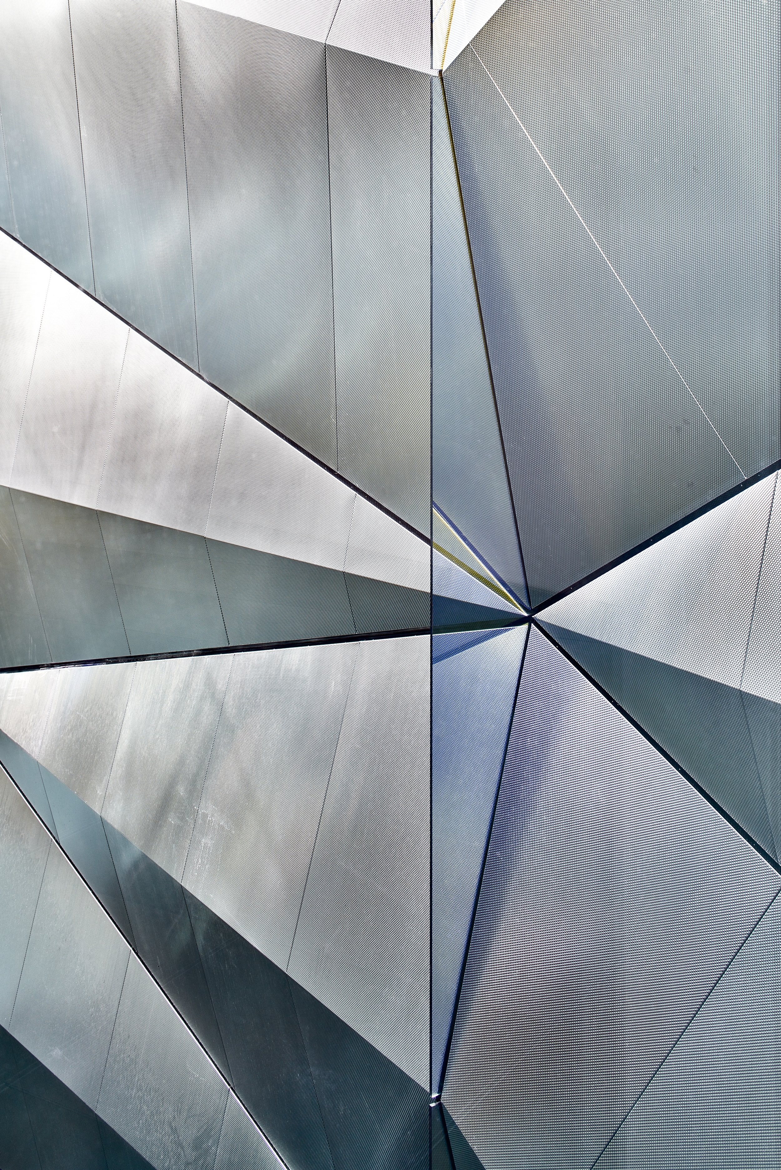 1 A close-up view of the folded semi-reflective surface and the vertical coated glass fin from the seventh floor © Timothy Soar.jpg