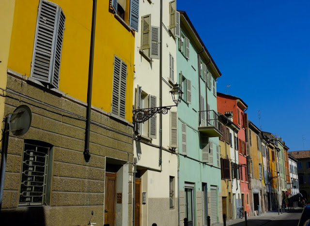 The colourful fascia of a Parma street