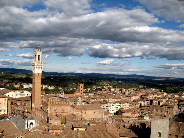 Siena, languishing under the moodiest of Italian skies