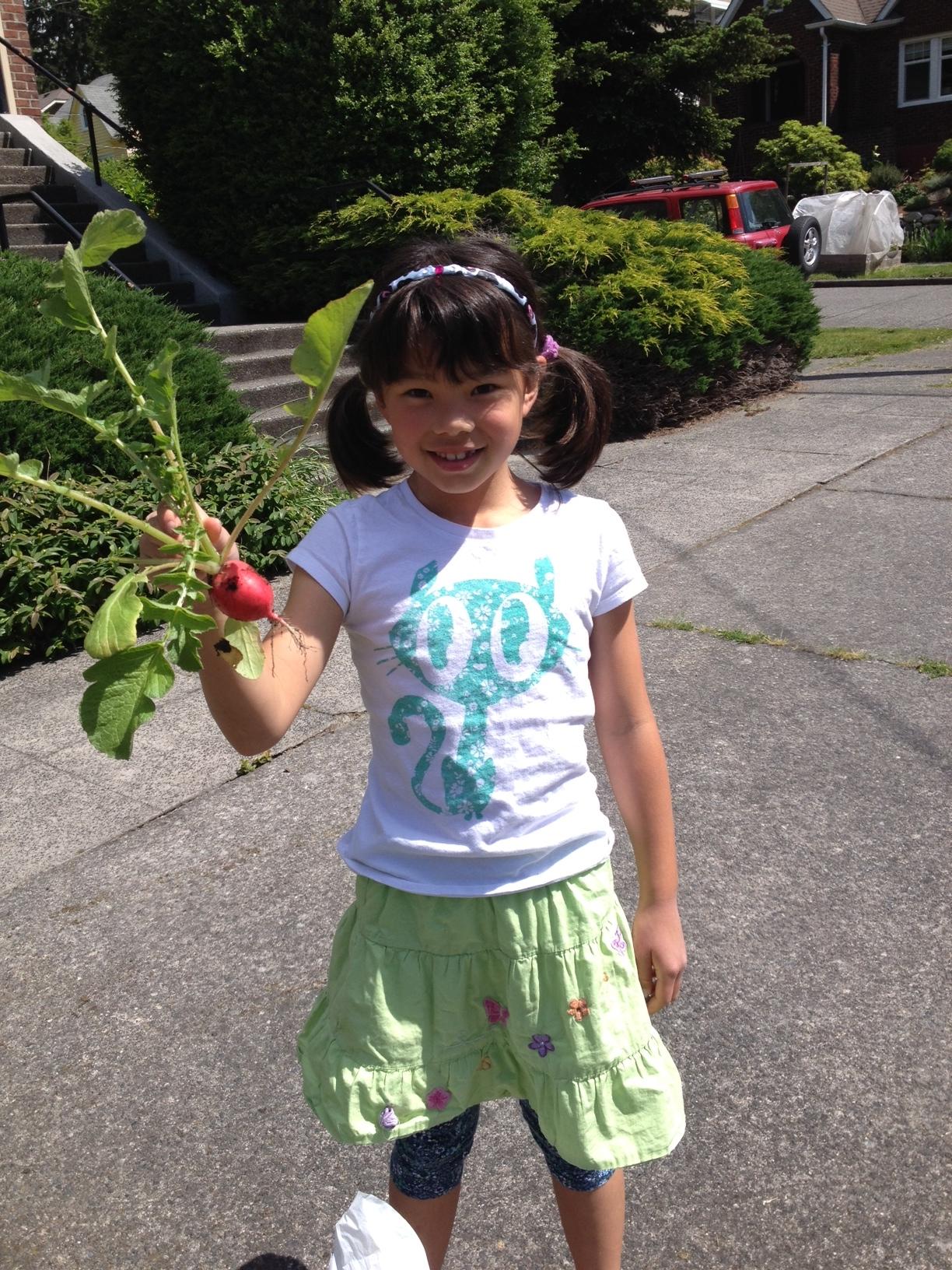 claire with radish.JPG