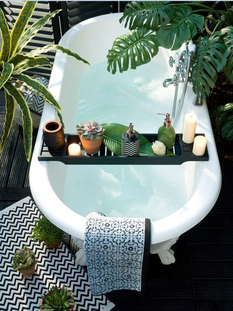 Bathtub with plants and candles
