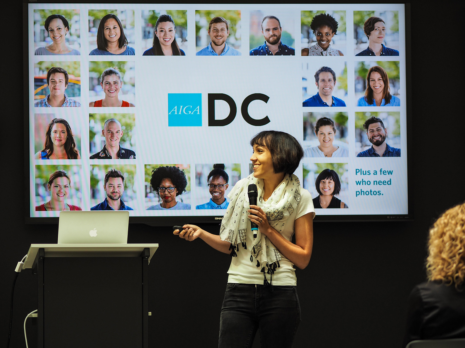 Ashleigh Axios speaks to AIGA Chicago in 2016 and highlights the AIGA DC board of directors. (Photo by  Chris Mendoza )
