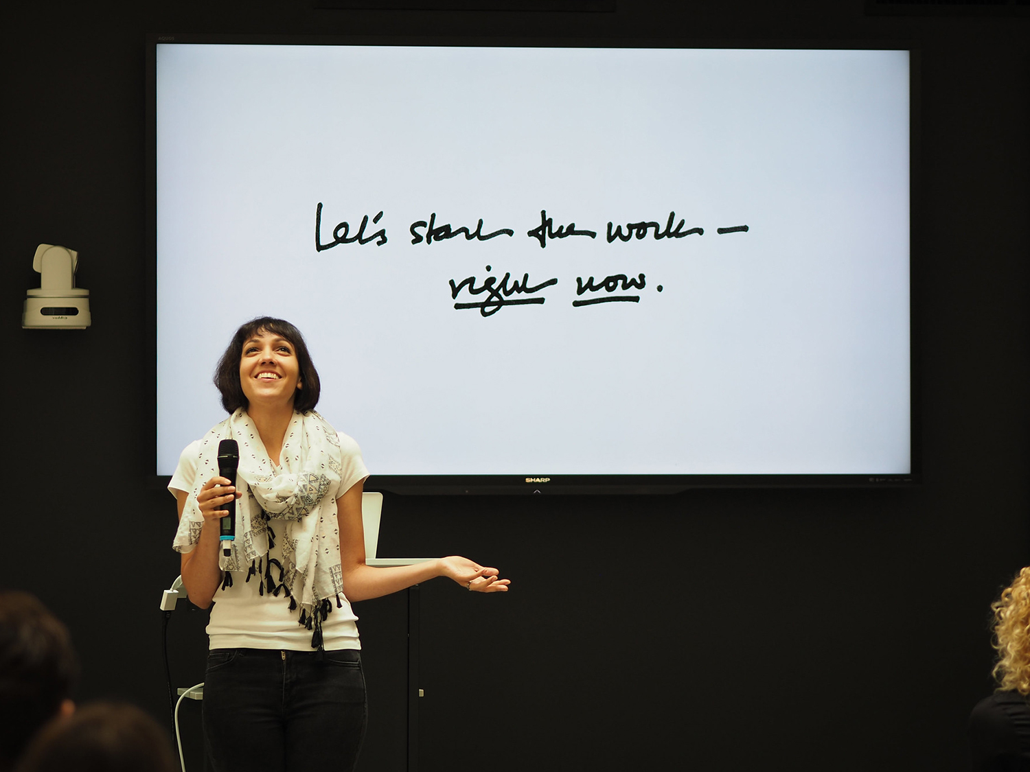Ashleigh Axios presenting at an event by AIGA Chicago. (Photograph by Chris Mendoza)