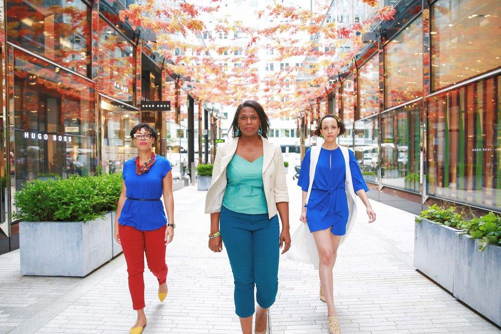 3 Black women walking facing the camera in City Center, Washington, D.C.  Photos:  Milli Mike / Millgrimage