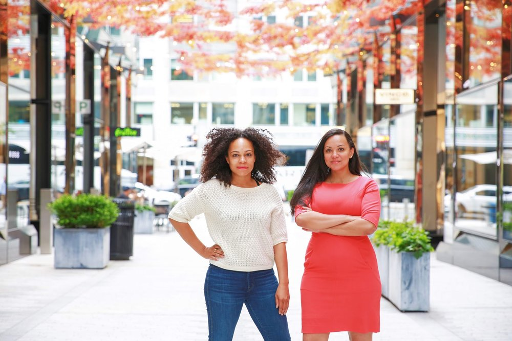 2 Black women in a strong stance facing the camera in City Center, Washington, D.C.  Photos:  Milli Mike / Millgrimage