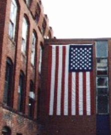 In the days after the attacks, on my daily walk, I sidetracked to the plant whose ancestors made the first American fabrics, using the little waterfall I could hear from my home, to power the mill.  I suggested to the mill's office receptionist that we make a flag and share it on the building - just dazed and determined - and they did it....my proudest art yet, I guess!  It hung there until it frayed, lit at night by the Amerbelle Mill, now sold on to developers.  Heart. Since those days, it is nice to see that the flag spirit has remained. We are one bit better at least.