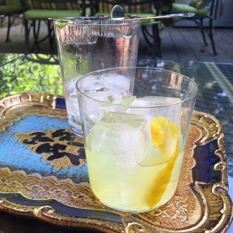 THE NORTH LEAGUE  1.5 oz Gin .25 oz Pernod .50 oz lemon juice .25-.50 oz gum syrup Lemon zest  Stir in ice, pour over ice.