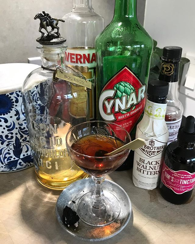 A lovely drink for fall! Simple and complex! Needing a name for it. Got any ideas? . 1 Oz. Bourbon 1/2 Oz. Averna 1/2 Oz Cynar 2 Dashes Walnut Bitters 3 Dashes Peyshauds Bitters 1/2 Vile Tim's Black Pepperwood Tincture™ 1/2 Inch piece of peat Or your favorite wood.  Mix ingredients (except for the peat) in a cocktail mixer. Pour into coupe glass. Add Italian cherry. Infuse with smoke. #peat #dublin @dropdead_twice @grubgrapegrain @dugdug7 @timmeaney #cynar #averna  @blantons_bourbon @averna