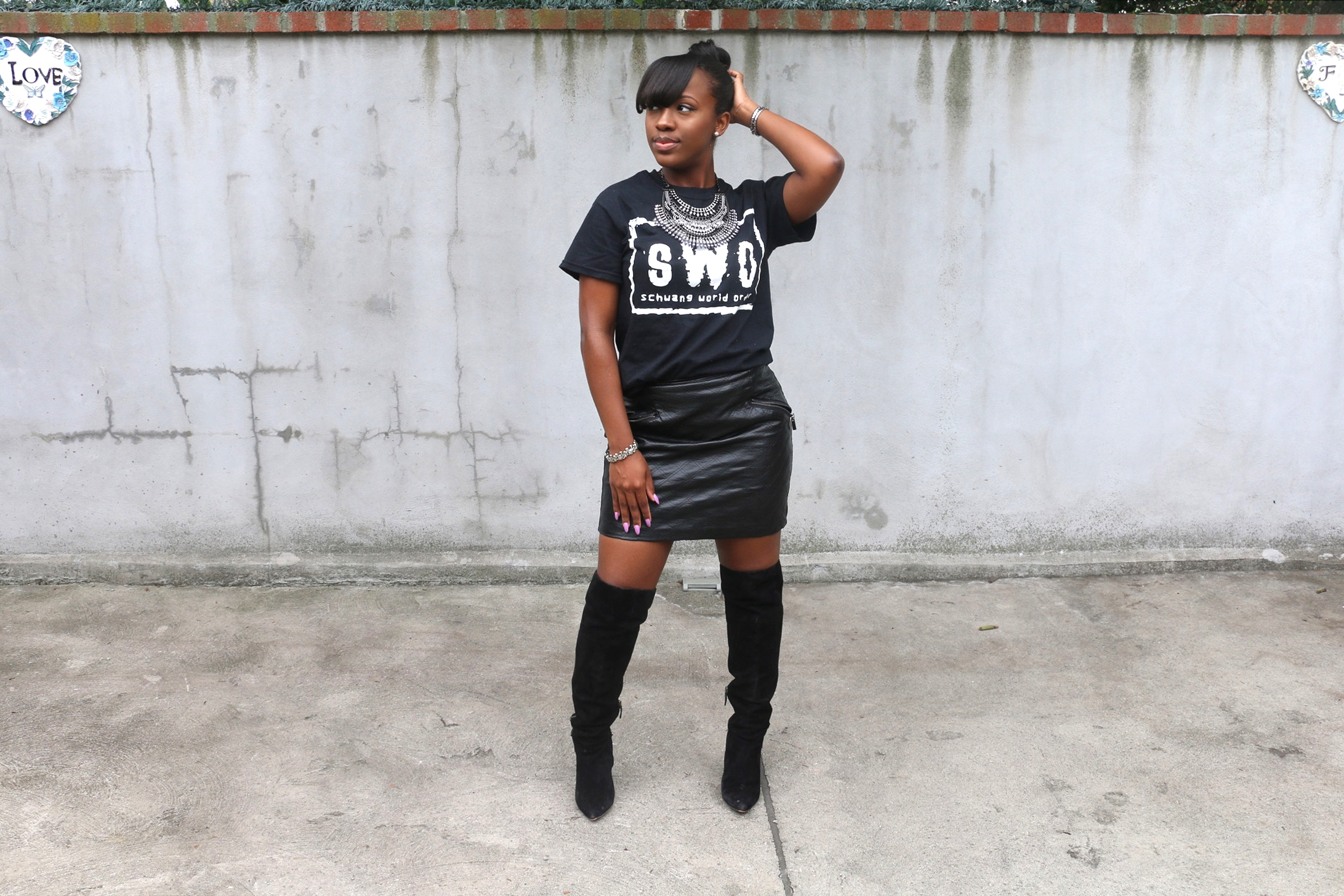 quilted leather skirt_over the knee boots_graphic tee