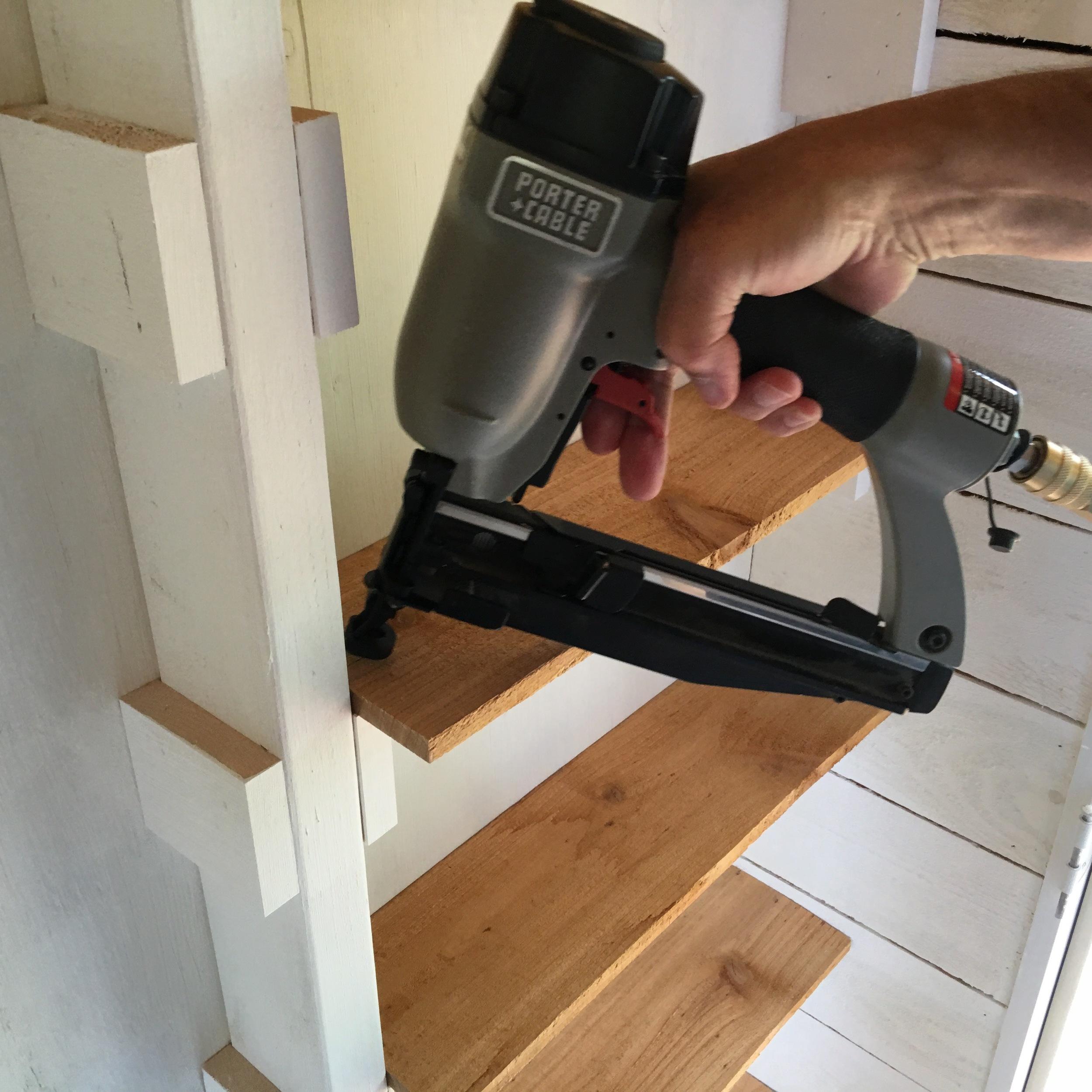 Tim installing the shelves.