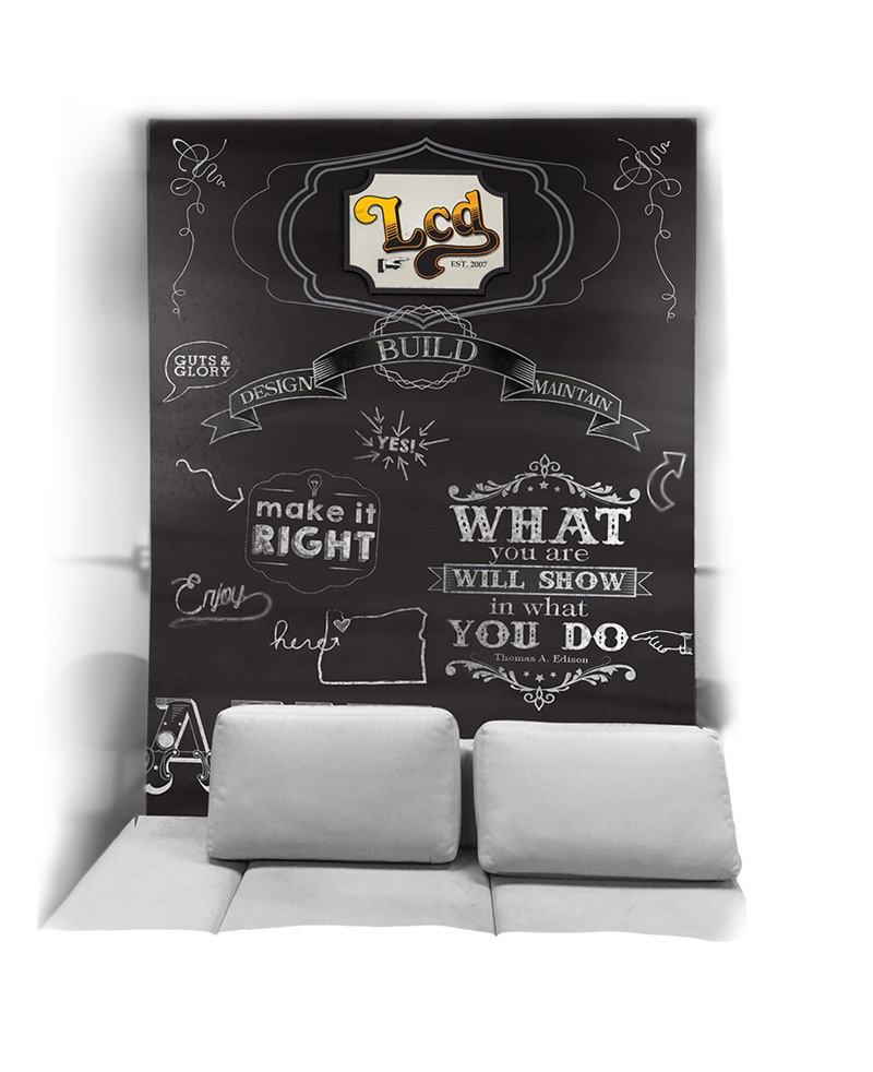 """Breakroom Wall #2 - Faux chalk wall (a real chalk wall was an option). The company slogan """"Design, Build, Maintain"""" featured prominently."""