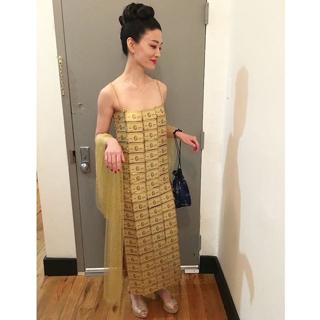 """With a stack of gold card stock and some chain, I recreated #LizzyGardiner's gorgeous American Express Gold dress that she wore to the 1995 Oscars and homegirl WON #BestCostumeDesign for 'Priscilla, Queen of the Desert'. I distinctly remember seeing this dress as a kid go down as one of the """"worst"""" #Oscardresses in history - but it's sitting in a museum right now! I've frankly never felt more elegant in this look and tried to make my homage as authentic as possible, cutting 200 custom printed cards and linking them all by hand. Here's to giving credit where credit is due 👸🏼💳💳💳🏆 @theacademy #oscars #academyawards #redcarpet #priscillaqueenofthedesert #americanexpress"""