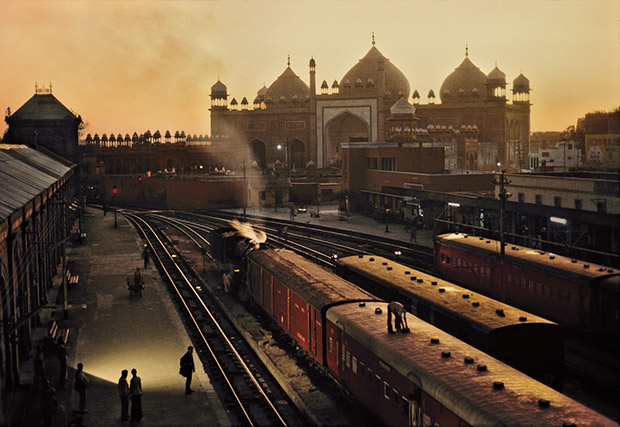 Train Station, Agra, India, 1983.     Copyright    Steve McCurry . This photo displays the quintessential India to me-the light, the romanticmogul architecture and the exciting and adventure boundtrains. India, in it's history, has had the ability to perfectly adapt to any foreign ideas that challenged it's own. It's reliance on nature as it's sole mentor has allowed the new to be incorporated into a robust nature-based paradigm. It is an example to emulate within our micro worlds.